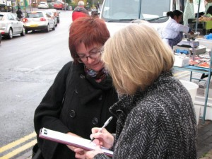 Councillor Lisa Trickett discussing council proposals with a member of the public